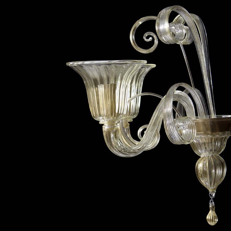 2 light Murano glass wall lamp, golden color.